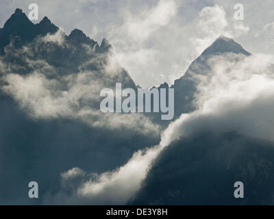 clouds rushing in, Jade Dragon Snow Mountains, Yunnan, China - Stock Photo