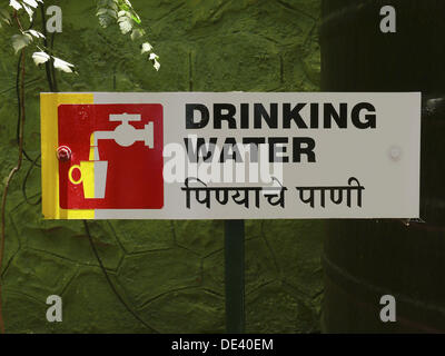 A sign board showing drinking water place wording in english and stock photo royalty free Cleansing concepts garden city