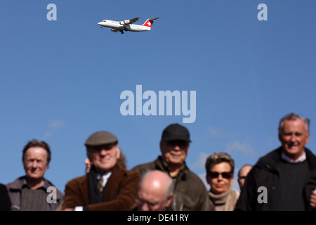 Hannover, Germany, SWISS aircraft over heads of people - Stock Photo