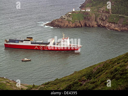 Ship entering the harbor at St. Johns, Newfoundland, Canada - Stock Photo