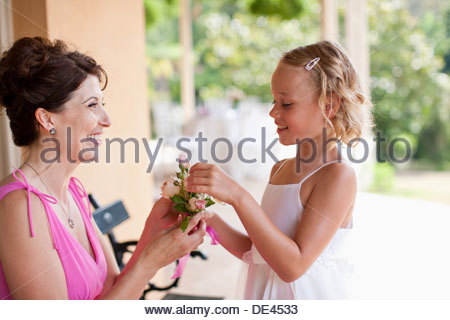 Woman and flower girl holding flower in hand - Stock Photo