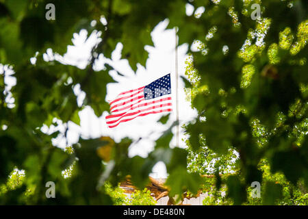 Grosvenor Square, London, UK. 11th Sep, 2013. The United States flag flies at hal mast at the US Embassy in London - Stock Photo