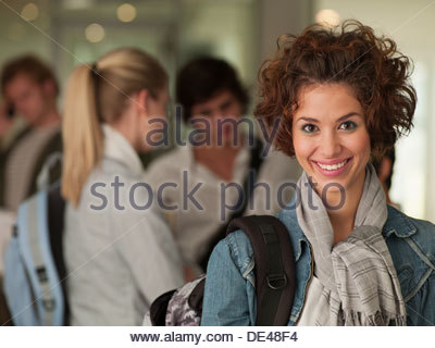 Female college student smiling in classroom - Stock Photo
