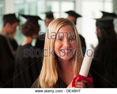 Smiling graduates collge student - Stock Photo