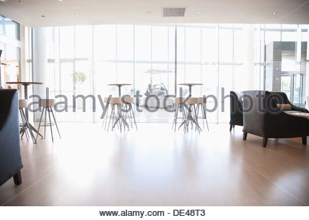 Tables and chairs in cafeteria - Stock Photo
