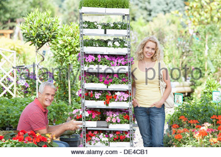 Couple buying flowers in nursery - Stock Photo