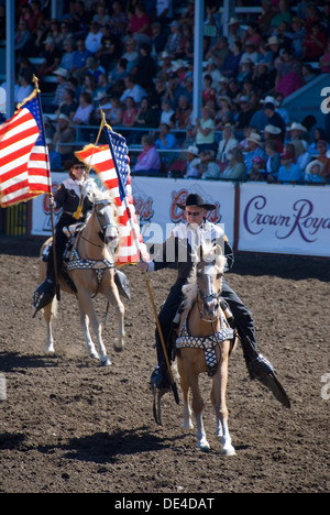 Cowboy Carrying An American Flag While Riding On A Horse