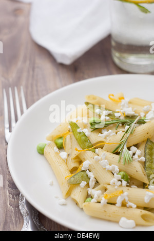 Delicious vegetarian pasta with green peas and feta cheese - Stock Photo