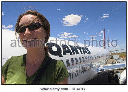 Woman and Qantas plane from Australia - Stock Photo