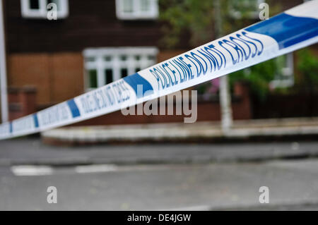 Belfast, Northern Ireland. 11th September 2013 - Police tape across a road saying 'Police Line Do Not Cross' Credit: - Stock Photo
