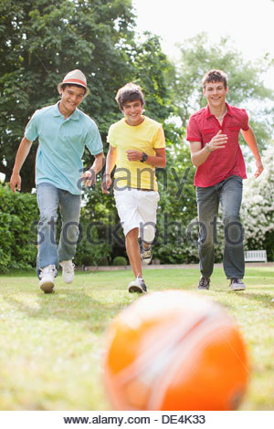 Teenage boys playing soccer together - Stock Photo