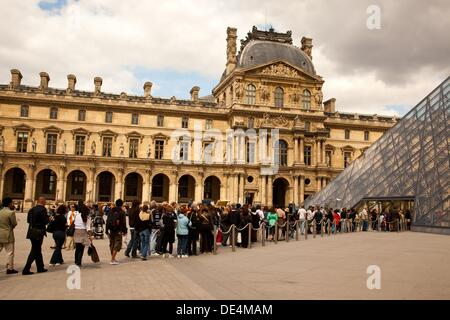 Line up of visitors waiting to enter the Louvre in Paris, France - Stock Photo
