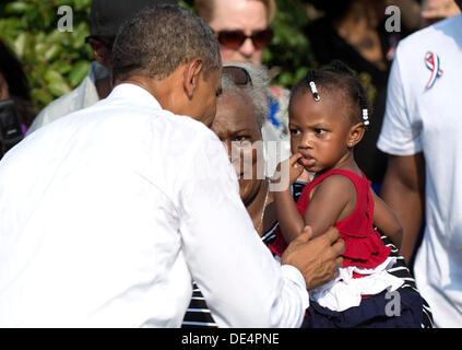 Arlington, Virginia, USA. 11th Sep, 2013. United States President Barack Obama greets Zoey Komongnan during a remembrance - Stock Photo