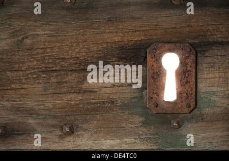Detail of an Old Door with Rusty Keyhole. Civita di Bagnoregio, Viterbo District, Lazio, Italy. - Stock Photo