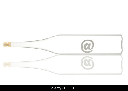 Horizontal glass bottle containing an at-sign - Stock Photo