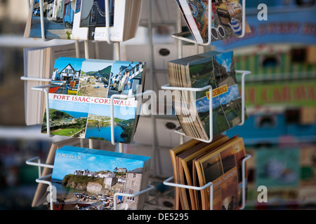 Postcards on sale in a postcard stand in the village of Port Isaac on Cornwalls North Coast. - Stock Photo
