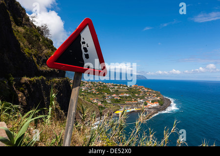 Sign, 'Beware falling rocks' on a country road along the coastal cliffs near Ponta Delgada, Vicente, Boaventura, - Stock Photo