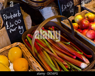 Traditional rural produce farm shop interior with fresh local Rhubarb and fruit on sale Cotswolds UK - Stock Photo