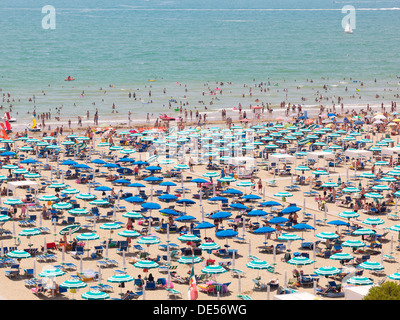 View of the beach with parasols, sun loungers and bathers, Lignano Sabbiadoro, Udine, Adriatic Coast, Italy, Europe - Stock Photo