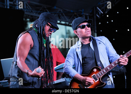 Jamaican British singer Maxi Priest and lead guitarist at the The Flyover Show, Hockley Circus, Birmingham, England, - Stock Photo