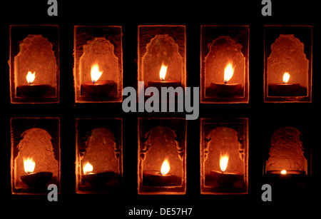 Oil lamps in wall niches, Mool Sagar Heritage Hotel near Jaisalmer, Rajasthan, India, Asia - Stock Photo