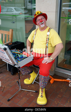 Happy looking middle aged man dressed as a clown, Vancouver, British Columbia, Canada - Stock Photo