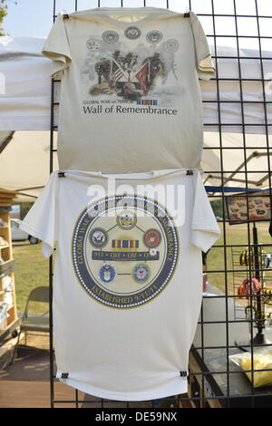 East Meadow, New York, U.S. 11th September 2013. T-shirts for sale are on disaply at the booth by the Global War - Stock Photo