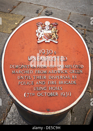 Plaque commemorating 1930s unemployed in Manchester UK - Stock Photo