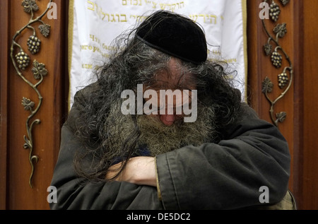 A religious Jew sleeping in a synagogue while seated. Jerusalem Israel - Stock Photo