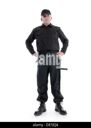Security man wearing black uniform equipped with police club and handcuffs standing confidently with hands resting - Stock Photo