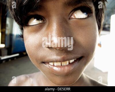 Untouchable boy in a station, Mumbai, Maharashtra, India - Stock Photo