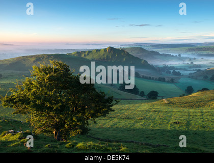 Dawn light hits Parkhouse Hill in the Peak District National Park Derbyshire England - Stock Photo