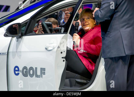 Frankfurt, Germany. 12th Sep, 2013. German Chancellor Angela Merkel (CDU) sits in a 'eGolf' car model of car manufacturer - Stock Photo