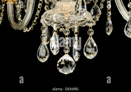 Contemporary glass chandelier crystals isolated over black background - Stock Photo