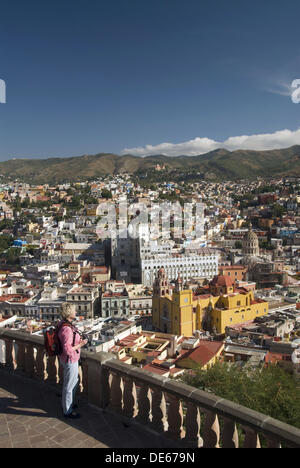 Overview of Guanajuato from the monument of El Pipila, tourist enjoying the city view, City of Guanajuato, Guanajuato, - Stock Photo