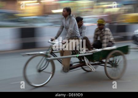 India, Uttar Pradesh, Old Delhi, cycle rickshaw and motion blur - Stock Photo