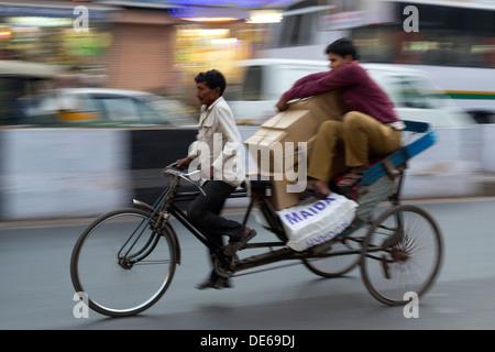 India, Uttar Pradesh, Near New Delhi Railway Station, blurred motion effect of cycle rickshaw - Stock Photo