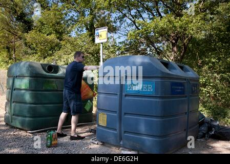 Man using recycle bins in Provence, France - Stock Photo