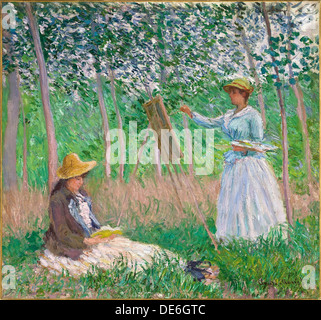 In the Woods at Giverny: Blanche Hoschedé at Her Easel with Suzanne Hoschedé Reading, 1887. Artist: Monet, Claude - Stock Photo