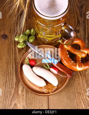 Oktoberfest menu - beer, white sausage, pretzel and radish, top view - Stock Photo