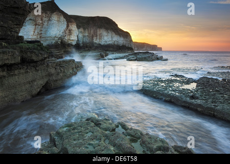 Crashing waves and cliffs at Thornwick Bay near Bridlington, East Yorkshire, UK - Stock Photo