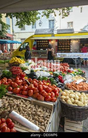 Fruit and vegetable stall at the sunday market on the streets of Le Puy-en-Velay in Auvergne region of France - Stock Photo
