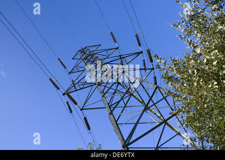 Electrical pylon or transmission tower used to circulate power along the national grid - Stock Photo