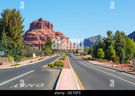 Highway and Bell Rock, Village of Oak Creek, near Sedona, Arizona - Stock Photo