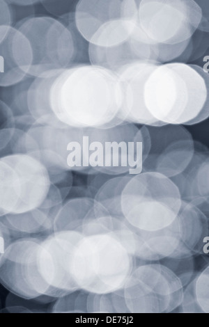Abstract defocused bokeh grey background of light and shadows - Stock Photo