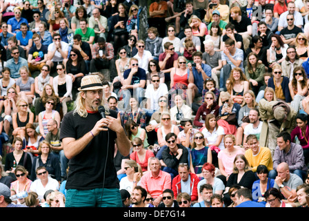 Berlin, Germany, singers and spectators at the Bearpit karaoke show at Wall Park - Stock Photo