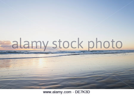 New Zealand, View of Ninety Mile Beach at sunset - Stock Photo