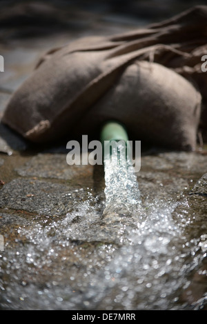 Muehl, Germany, sandbags fix a hose while pumping out a basement - Stock Photo