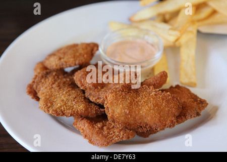 Deep fried breaded chicken nuggets with chips - Stock Photo