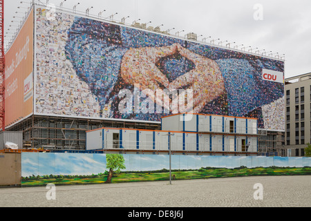 Large poster of the CDU German Chancellor Angela Merkel,  with a typical attitude called the 'Merkel rhombus', Berlin - Stock Photo